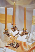 Candlestick with candles on wedding ceremony detail — Stock Photo