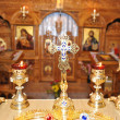 Cross and candlesticks in the church — Stock Photo