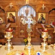 Cross and candlesticks in the church - Stock Photo