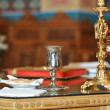 Stock Photo: Cup and candlestick in the church