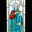 Stained glass window depicting Saint in the church - Stock Photo