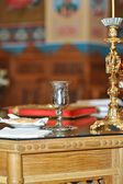 Cup and candlestick in the church — Stock Photo