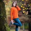 Portrait of pretty teen girl in autumn park .Smiling happy girl portrait, autumn outdoor. - Stock Photo