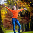 Portrait of pretty teen girl in autumn park .Smiling happy girl portrait, autumn outdoor. — Stock Photo #22786652