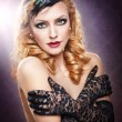 Closeup portrait of a topless blonde woman wearing black lace gloves.Fashionable portrait of the long blond-haired girl with long gloves.Portrait of beautiful topless fashion model with long hair — Stock Photo