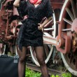 Sexy attractive girl waiting for landing on the platform in the vintage train.Vintage woman in twenties style waiting for the train.Retro-styled woman with suitcase on the platform waiting for train — Stock Photo