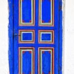 Colored door peasant.old wooden door.Old colored wooden door front view — Stock Photo #24794525