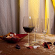 Two glasses of red wine on a table in a vintage room — Stock Photo