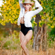 Fashion portrait woman with hat and white shirt in the autumn day.Very cute blond woman outdoor with a hat in a autumn forest.Young sensual blonde girl — Stock Photo