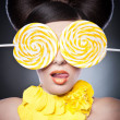 Beautiful girl with slices lemon as necklace.Portrait of a woman with oranges as a accessories. Fashion model with creative food vegetable make-up .Sensual woman with luxury makeup and hair style — Stock Photo