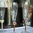 Two glasses of cold champagne .Two wedding glasses of groom and bride on the table — Stock Photo
