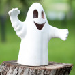 Ghost statue .ceramic ghost on a stump in the park — Stock Photo