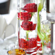 Decoration of summer garden table. Roses in vase on white table — Stock Photo #26736033