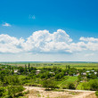 Romanian countryside landscape, village.Group of houses in the countryside. Sunny summer day and blue sky.old rural house.Romanian Farmland With Blue Sky and green meadows.Grassland and houses — Stock Photo