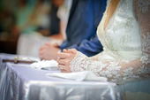 Closeup shot of hands of a bride. Bride's hand with engagement ring on and long lace sleeve — Stock Photo