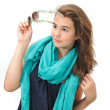 Beautiful teen girl with sunglasses and blue scarf posing. Dynamic image of teen girl with sunglasses on her head isolated on white background — Stock Photo #30668035