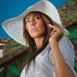 Portrait of attractive beautiful young woman in summer cap closeup, against blue sky.Woman with sun hat  — Stock Photo