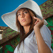 Portrait of attractive beautiful young woman in summer cap closeup, against blue sky.Woman with sun hat — Stock Photo #31277825