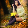 Young caucasian sensual woman in a romantic autumn scenery .Fall lady .Fashion portrait of a beautiful young woman in autumn forest. Beauty autumn  — Stock Photo