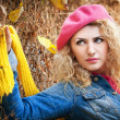 Beautiful elegant woman in autumn park . Young pretty woman at the autumn park. Beautiful woman with pink hat and blouse spending time in park in autumn season. Young pretty woman in the autumn park — Stock Photo