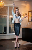 Sensual elegant woman in office outfit posing fashion. Beautiful and sexy blonde young woman wearing sexy bra and elegant jacket posing challenging. Fashionable model in black skirt and white jacket — Stock Photo