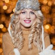 Fashionable lady wearing cap and muffler coat outdoor winter. Portrait of young beautiful woman in winter style. Bright picture of beautiful blonde woman with make up — Stock Photo #37610915