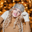 Fashionable lady wearing cap and muffler coat outdoor winter. Portrait of young beautiful woman in winter style. Bright picture of beautiful blonde woman with make up — Stock Photo #37610937