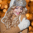 Fashionable lady wearing cap and muffler coat outdoor winter. Portrait of young beautiful woman in winter style. Bright picture of beautiful blonde woman with make up — Stock Photo #37610951