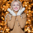 Fashionable lady wearing cap and muffler coat outdoor winter. Portrait of young beautiful woman in winter style. Bright picture of beautiful blonde woman with make up — Stock Photo #37610957