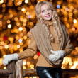 Fashionable lady wearing cap and muffler coat outdoor winter. Portrait of young beautiful womin winter style. Bright picture of beautiful blonde womwith make up — Stock Photo #37610989