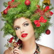 Beautiful creative Xmas makeup and hair style indoor shoot. Beauty Fashion Model Girl. Winter. Beautiful fashionable in studio. Attractive girl with Christmas tree accessories. Luxuriant. Femininity. — Stock Photo