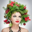 Beautiful creative Xmas makeup and hair style indoor shoot. Beauty Fashion Model Girl. Winter. Beautiful fashionable in studio. Attractive girl with Christmas tree accessories. Luxuriant. Femininity. — Stock Photo #37872747