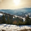 Majestic sunset in the mountains landscape. Sunset landscape in Carpathian mountains. Dawn in mountains Carpathians, Romania. Mountains covered with snow — Stock Photo #38140057
