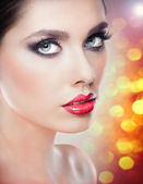 Hairstyle and Make up - beautiful female art portrait with beautiful eyes. Elegance. Genuine Natural brunette in studio. Portrait of a attractive woman with red lips and naked shoulders — Stock Photo
