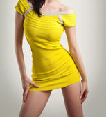 Sexy girl in yellow short dress isolated on white background, studio shot. Attractive model in fashion concept — Stock Photo