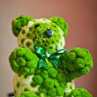 Wedding guest table set for an event. Green bear decoration on restaurant table. Teddy bear made by green flowers to decorate an elegant wedding table. — Foto Stock #42020619
