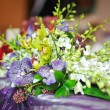 ������, ������: Beautiful bouquet of wild flowers on table Wedding bouquet of white an mauve flowers Elegant wedding bouquet on table at restaurant Floral arrangements on wedding ceremony detail