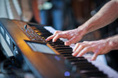 Closeup shot of male hands playing the piano. Human hands playing the piano on the party.  Man playing the synthesizer keyboard — Stock Photo