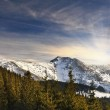 Majestic sunset in the mountains landscape. Sunset landscape in Carpathian mountains. Dawn in mountains Carpathians, Romania. Mountains covered with snow — Stock Photo #42278003