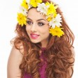 Portrait of beautiful girl in studio with yellow and white chrysanthemums in her hair. Sexy young woman with blue eyes and bright flowers. Creative hairstyle and makeup, fashion photo studio shot — Stock Photo