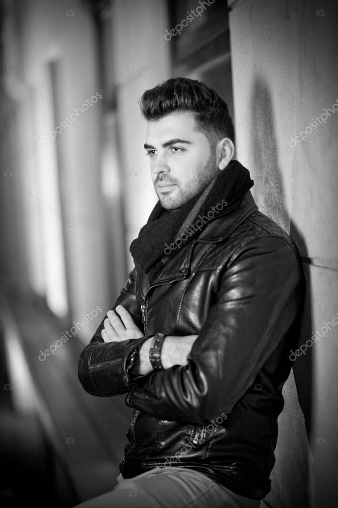 Top View Of Handsome Male Model In Leather Jacket Posing