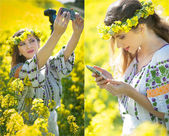 Young girl wearing Romanian traditional blouse taking selfie in canola field, outdoor shot. Portrait of beautiful blonde with flowers wreath holding her mobile in bright yellow rapeseed field — Stock Photo