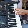 Closeup shot of male hands playing the piano .Human hands playing the piano on the party . Man playing the synthesizer keyboard — Stock Photo #48110853