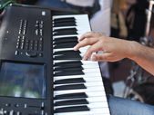 Closeup shot of male hands playing the piano .Human hands playing the piano on the party . Man playing the synthesizer keyboard — Stock Photo