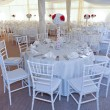 Wedding tables setting in white color. Tables set for an event party or wedding reception. Elegant table setting in restaurant. White arrangement for wedding. — Stock Photo #48483037