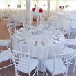 Wedding tables setting in white color. Tables set for an event party or wedding reception. Elegant table setting in restaurant. White arrangement for wedding. — Stock Photo #48483045