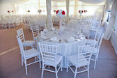 Wedding tables setting in white color. Tables set for an event party or wedding reception. Elegant table setting in restaurant. White arrangement for wedding. — Stock Photo