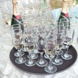 Wedding decor, wine glasses and champagne flutes on table. Decoration with bottles and glasses of champagne on festive table. Luxurious wedding decoration on restaurant table. Elegant event — Stock Photo #50537775