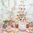 Wedding decoration with pastel colored cupcakes, meringues, muffins and macarons. Elegant and luxurious event arrangement with colorful macaroons. Wedding dessert with macaroons — Stock Photo #50537779