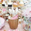 Wedding decoration with pastel colored cupcakes, meringues, muffins and macarons. Elegant and luxurious event arrangement with colorful macaroons. Wedding dessert with macaroons — 图库照片 #50537807